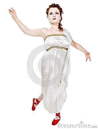 Girl dressed in greek costume dancing on white