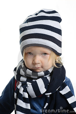 Girl dressed with winter hat and scarf