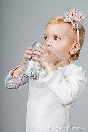Girl drink water from a glass.
