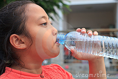 Girl drinking fresh water from bottle