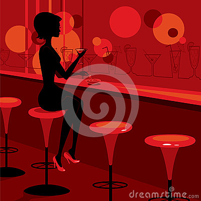 Girl drinking martini in the bar