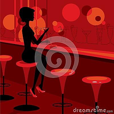 Girl drinking martini in the bar