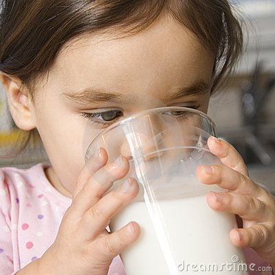 Girl drinking milk.