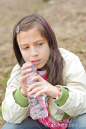 Girl drinking mineral water