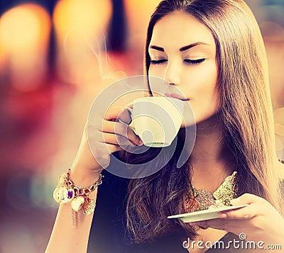 Girl Drinking Tea or Coffee