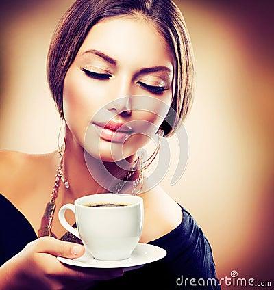 Free Girl Drinking Tea Or Coffee Stock Photography - 27989352