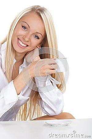 The girl drinks coffee