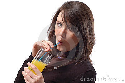 The girl drinks juice