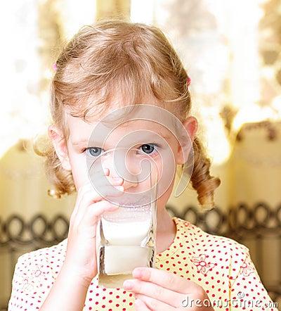 Girl drinks milk