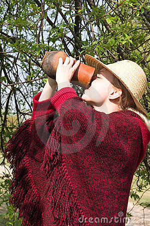Girl drinks milk from a jug