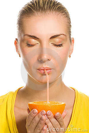 Girl drinks orange juice