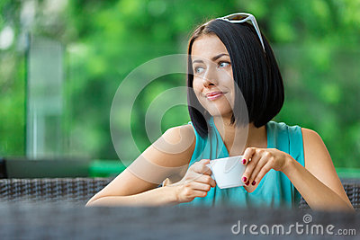 Girl drinks tea at the bar
