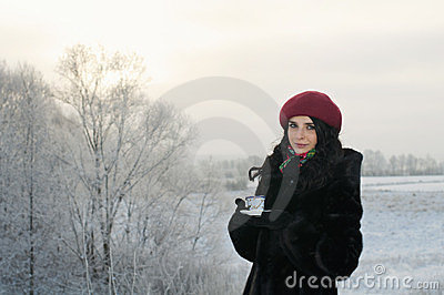 Girl drinks tea on a winter morning
