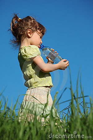 Girl drinks water from plastic bottle