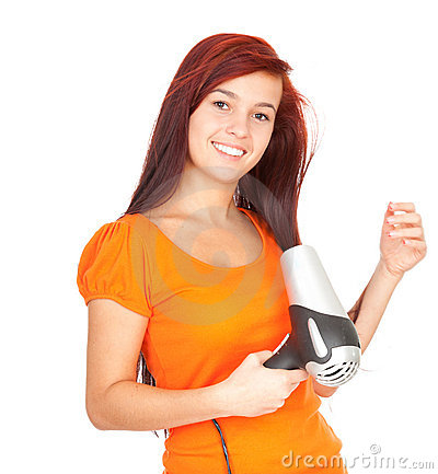 Girl drying her hair by dryer