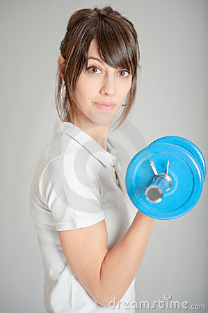 Girl with dumbbell