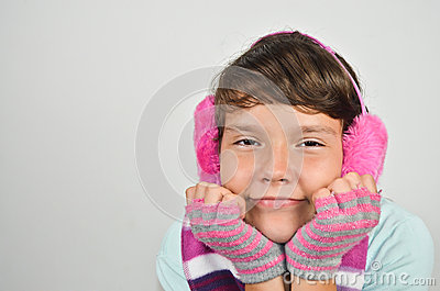 Girl with ear muffs and trimmed gloves
