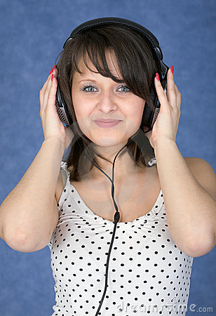 Girl in ear-phones on a blue background