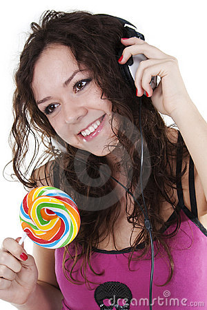 Girl in ear-phones dances and eats a lollipop