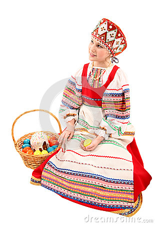 Girl with Easter eggs and a holiday cake