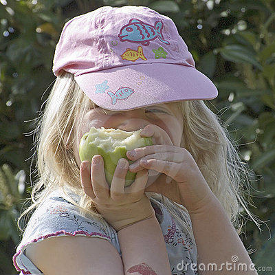 Free Girl Eating A Green Apple Stock Image - 2306241