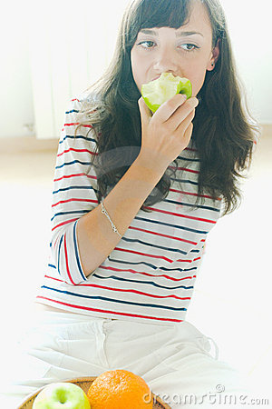 Girl eating an apple