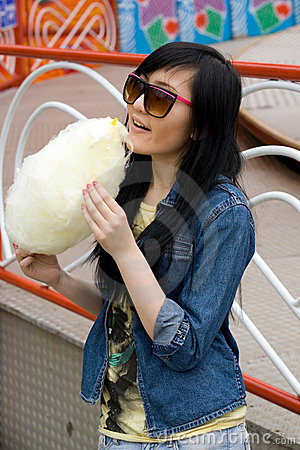 Girl eating candy floss
