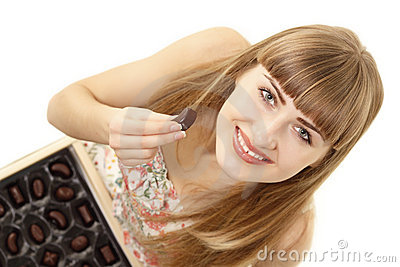 Girl eating chocolate candy