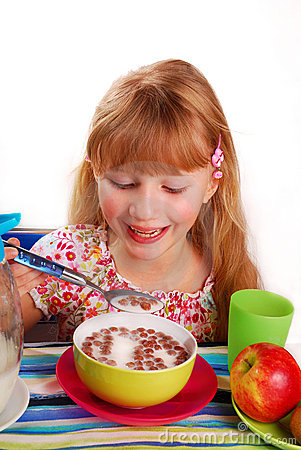 Girl eating chocolate cornflakes