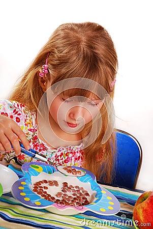 Girl eating chocolate cornflakes