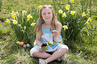 Girl Eating Chocolate Egg On Easter Egg Hunt