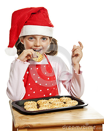 Girl eating Christmas cookies