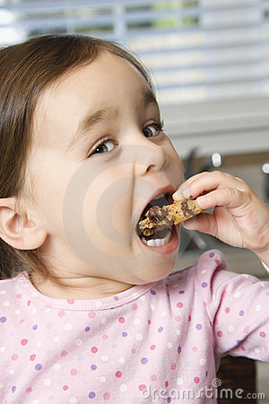 Girl eating cookie.