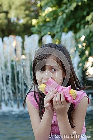 Girl eating corn