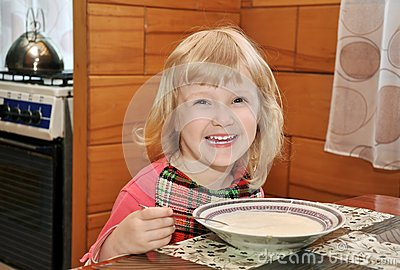 Girl is eating cream of wheat