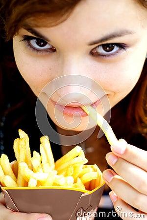 Girl eating fries