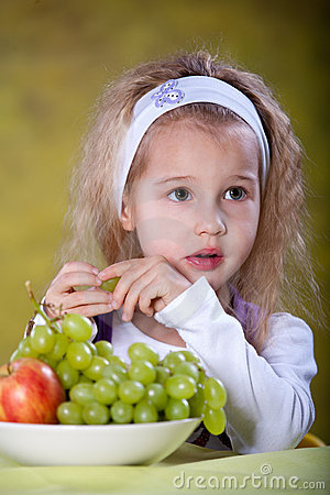 Girl Eating Grapes Stock Photo - Image: 18713760