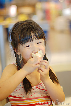 Girl eating ice-cream cone