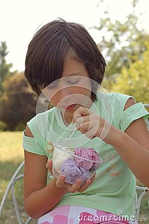 Free Girl Eating Ice Cream Outdoors Royalty Free Stock Photos - 6161208