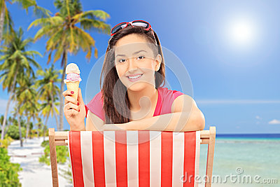 Girl eating ice cream on a tropical beach