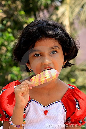Girl eating ice lolly