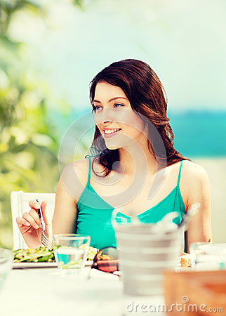 Free Girl Eating In Cafe On The Beach Stock Photos - 43463433