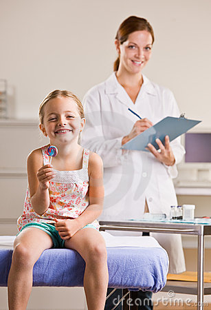 Girl eating lollipop in doctor office