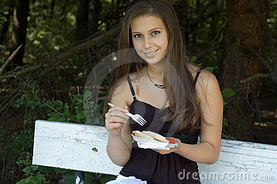 Girl eating lunch outdoors
