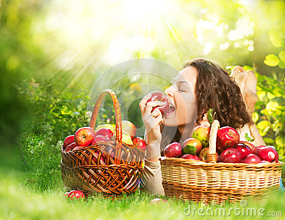 Girl Eating Organic Apple in the Orchard