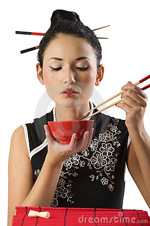 Free Girl Eating Oriental Food Stock Photo - 12358620