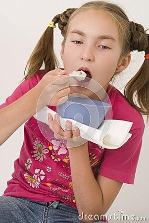 Girl eating porridge III