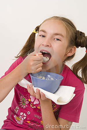 Girl eating porridge IV