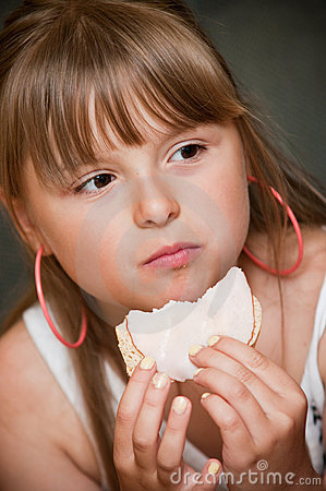 Girl eating sandwich