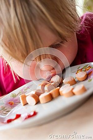 Girl eating sausages